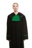Kobieta prawnika adwokat jest ubranym czerni zieloną togę Obraz Royalty Free