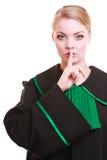 Kobieta prawnika adwokat jest ubranym klasyczną połysk togę pyta dla ciszy Obrazy Stock