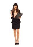 Kobieta Przy pracą z listą kontrolną zdjęcie royalty free