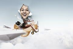 Kobieta przyglądająca za dziurze poszarpany papier i jazda od zabawkarski samolotowy kolaż zdjęcia stock