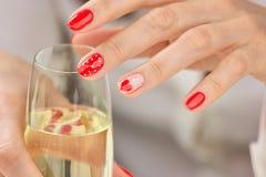 Kobieta robiący manikiur szampan i ręki Obrazy Royalty Free