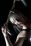 Kobieta robi skrętowi od jej włosy Zdjęcia Stock