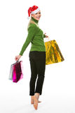 Kobieta robi zakupy dla bożych narodzeń Zdjęcia Royalty Free