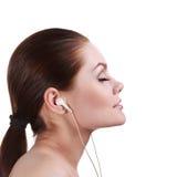 kobieta słuchająca muzyka Fotografia Stock