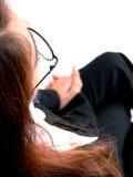 kobieta, siedząca usłyszała Obrazy Royalty Free