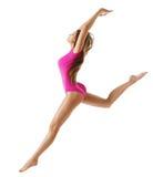 Kobieta sporta gimnastyczka, młoda dziewczyna tana skok, Szczupły Sporty ciało obrazy stock