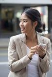 kobieta texting jednostek gospodarczych Obraz Royalty Free