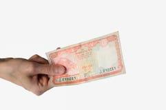 Kobieta trzyma dwadzieścia Nepal rupii notatkę w jej ręce Obraz Stock