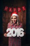 Kobieta trzyma 2016 liczb, boże narodzenie temat Fotografia Stock