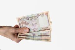 Kobieta trzyma trzydzieści Nepal rupii notatek w ona ręka Fotografia Royalty Free