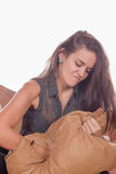Kobieta uderza pięścią poduszkę Obraz Royalty Free