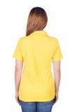 Kobieta w żółtej polo koszula odizolowywającej na białym tło plecy si Fotografia Stock