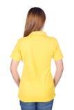 Kobieta w żółtej polo koszula odizolowywającej na białym tło plecy si Obraz Royalty Free