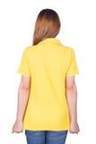 Kobieta w żółtej polo koszula odizolowywającej na białym tło plecy si Fotografia Royalty Free