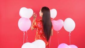 Kobieta w chińczyk sukni z balonem zbiory