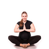 Kobieta w ciąży ćwiczyć odizolowywam na bielu Fotografia Stock