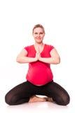 Kobieta w ciąży ćwiczyć odizolowywam na bielu Zdjęcie Stock