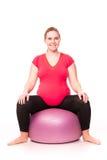 Kobieta w ciąży ćwiczy na bielu Zdjęcia Stock