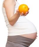 Kobieta w ciąży i pomarańcze Obraz Royalty Free