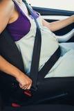 Kobieta w ciąży odzieży zbawczy pasek zdjęcia stock