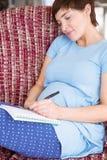 Kobieta w ciąży pozyci dziecka imiona fotografia stock