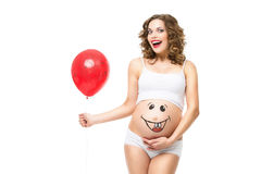 Kobieta w ciąży z balonem zdjęcia stock