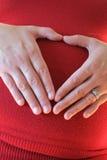Kobieta w ciąży z bożonarodzeniowe światła Zdjęcia Stock
