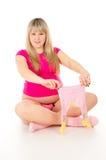 Kobieta w ciąży z dzieckiem odziewa Obraz Royalty Free