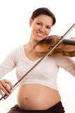 Kobieta w ciąży z skrzypce na biel Obraz Stock