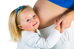 Kobieta w ciąży z 2 yo córką Zdjęcia Stock