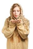 Kobieta w ciepłym comforter dmuchaniu Obrazy Royalty Free