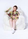 Kobieta w ciąży w fotelu Zdjęcia Royalty Free