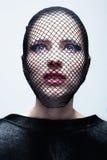 Kobieta w czarnej przesłonie Zdjęcia Royalty Free