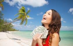 Kobieta w czerwieni sukni z dolara amerykańskiego pieniądze zdjęcie royalty free