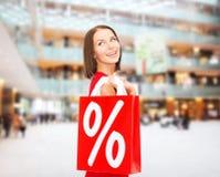Kobieta w czerwieni sukni z torba na zakupy Obraz Stock