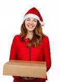 Kobieta w czerwieni sukni z wiele prezentów pudełkami Fotografia Stock