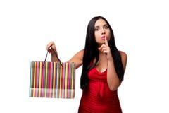 Kobieta w czerwonych dresach po robić zakupy odizolowywam na bielu Fotografia Stock