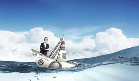 Kobieta w dolarowej łodzi Fotografia Royalty Free