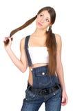 Kobieta w drelichowych kombinezonach Zdjęcia Stock