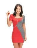 Kobieta w eleganckiej sukni słuchającej muzyce Zdjęcia Stock
