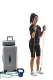 Kobieta w EMS kostiumu robi ćwiczeniu z expander Zdjęcia Stock