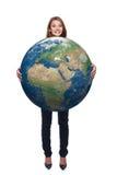 Kobieta w pełnej długości mienia ziemi kuli ziemskiej Zdjęcie Royalty Free