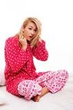 Kobieta w pyjamas target281_1_ obrazy royalty free