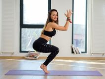 Kobieta w różnorodnych joga posturach obrazy stock