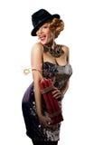 Kobieta w rocznika stylu smokingowym i kapeluszowym mienie dynamicie obrazy stock