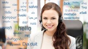 Kobieta w słuchawki nad słowami w językach obcych obraz stock
