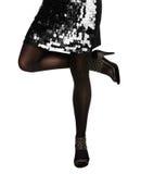 Kobieta w sandlas i cekinu sukni Fotografia Royalty Free