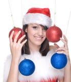 Kobieta w Santa dekoraci i sukni piłkach Zdjęcie Stock