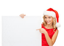 Kobieta w Santa pomagiera kapeluszu z pustą białą deską Zdjęcie Royalty Free