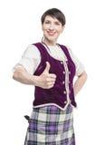 Kobieta w tradycyjnej odzieży dla Szkockiego tana pokazuje kciuki Zdjęcia Stock